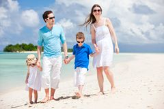 Happy family on tropical vacation Royalty Free Stock Image