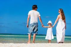 Happy family on tropical vacation Stock Photos