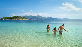 Happy family in tropical water stock image