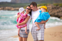 Happy family with twins on sun holidays Stock Photos