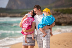Happy family with twins on sun holidays Royalty Free Stock Photo