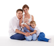 Happy family with two babies. Stock Image