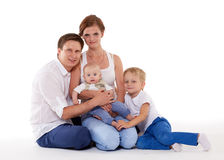 Happy family with two babies. Stock Photography