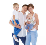 Happy family with two babies. Royalty Free Stock Photo