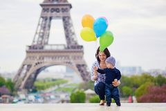 Happy family of two with bunch of colorful balloons in Paris royalty free stock image