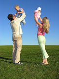 Happy family with two children on blue sky. Happy family with two children on hads on blue sky Royalty Free Stock Photo