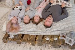 Happy family with two children lying on bed Royalty Free Stock Photos