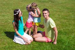 Happy family with two children outdoors on summer Stock Photo