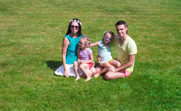 Happy family with two children outdoors on summer Royalty Free Stock Photo
