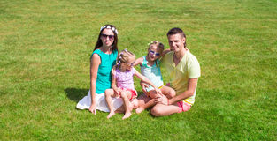 Happy family with two children outdoors on summer Stock Images
