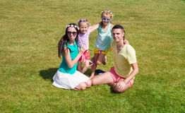Happy family with two children outdoors on summer Royalty Free Stock Images