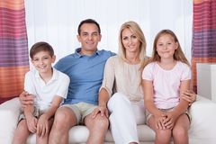 A happy family with two children Stock Photos