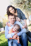 Happy family with two children in spring Royalty Free Stock Photography