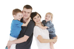 Happy family with two children on white Stock Photography