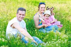 Happy family with two daughters outdoors Stock Images
