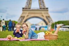 Happy family of two having picnic in Paris Stock Photography