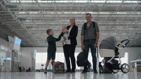 Happy family with two kids at the airport stock footage