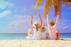 Happy family with two kids on the beach Royalty Free Stock Images