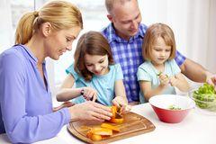 Happy family with two kids cooking at home Royalty Free Stock Photos