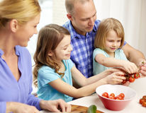 Happy family with two kids cooking at home Royalty Free Stock Images