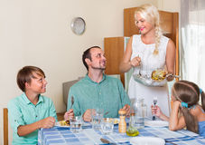 Happy family with two kids dining Stock Photography