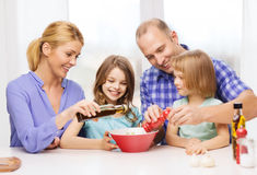 Happy family with two kids eating at home Stock Photos