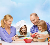 Happy family with two kids eating at home Stock Photo