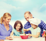 Happy family with two kids eating at home Royalty Free Stock Images