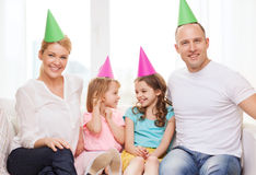 Happy family with two kids in hats celebrating Stock Images