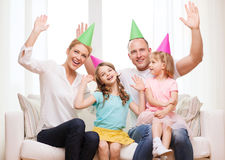 Happy family with two kids in hats celebrating Stock Photo