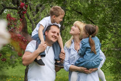 Happy family with two kids having fun in garden Royalty Free Stock Image