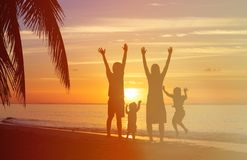 Happy family with two kids having fun at sunset Stock Images