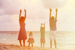 Happy family with two kids having fun at sunset Stock Image