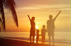 Happy family with two kids having fun on sunset Stock Photo