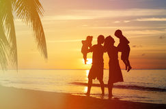 Happy family with two kids having fun on sunset Royalty Free Stock Images