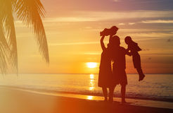 Happy family with two kids having fun on sunset Stock Photos