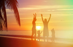 Happy family with two kids having fun on sunset Stock Image