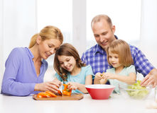Happy family with two kids making dinner at home Royalty Free Stock Images