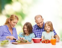 Happy family with two kids making dinner at home Royalty Free Stock Photos