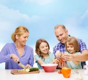 Happy family with two kids making dinner at home Royalty Free Stock Photography