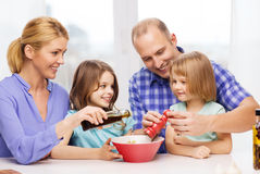 Happy family with two kids making dinner at home Stock Photography