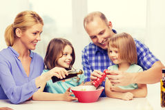 Happy family with two kids making dinner at home. Food, family, children, hapiness and people concept - happy family with two kids making dinner at home Stock Photography
