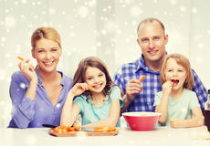 Happy family with two kids making dinner at home. Food, family, children, happiness and people concept - happy family with two kids making dinner at home Royalty Free Stock Photography