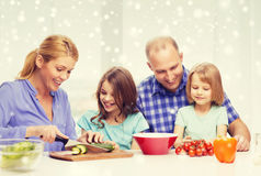 Happy family with two kids making dinner at home. Food, family, children, happiness and people concept - happy family with two kids making dinner at home Stock Photography