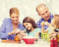 Happy family with two kids making dinner at home. Food, family, children, happiness and people concept - happy family with two kids making dinner at home Royalty Free Stock Photo