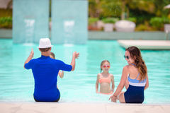 Happy family with two kids in outdoor pool Stock Images