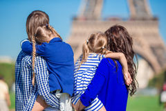 Happy family with two kids in Paris near Eiffel tower Stock Photo