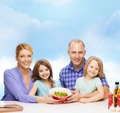 Happy family with two kids with salad at home Royalty Free Stock Photography
