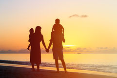 Happy family with two kids at sunset beach Royalty Free Stock Images