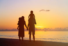 Happy family with two kids on sunset beach Stock Photography